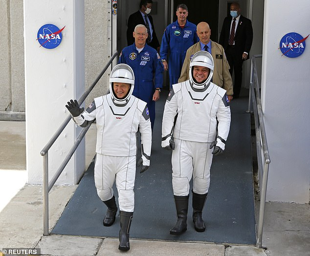 NASA astronauts Robert Behnken (right) and Douglas Hurley (left) walked out of the Kennedy crew's quarters dressed in elegant white costumes that appeared to be a mixture of a tuxedo and a superhero costume