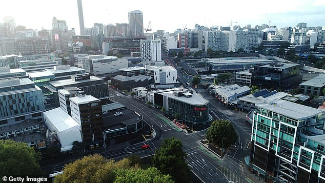 An intersection in Auckland, New Zealand, which is usually full of morning commuters is deserted on first day of the mandated coronavirus shutdown (pictured March 26, 2020)