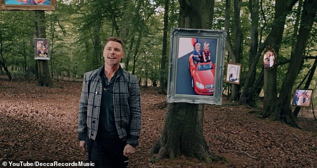 Moving: The video shows Ronan wandering through a forest surrounded by pictures and videos of his fans, as they are kept apart by the COVID-19 lockdown