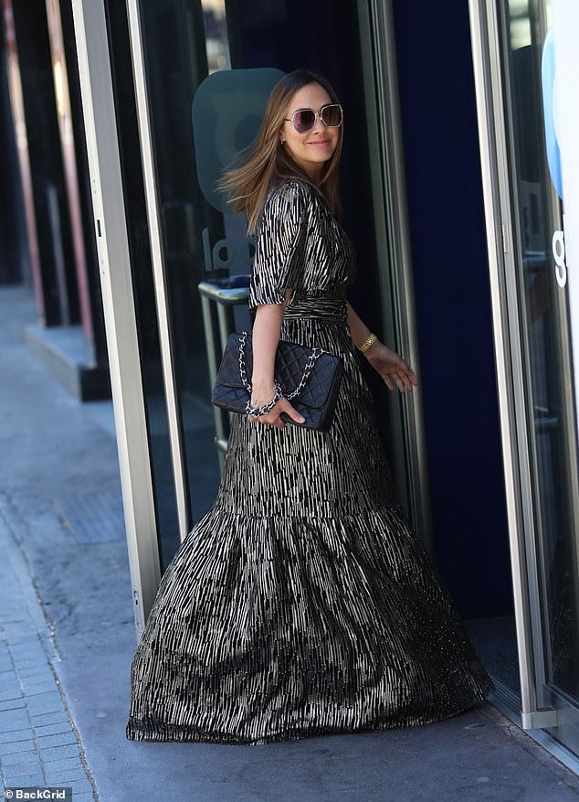 Style Queen:The presenter, 42, was the epitome of chic as she sauntered into the London building in the glamorous number, while clutching a designer handbag