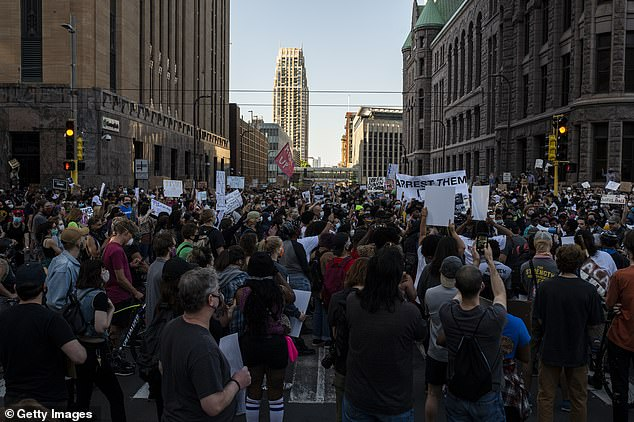 Protesters also took to the streets to march in downtown Minneapolis, Minnesota yesterday