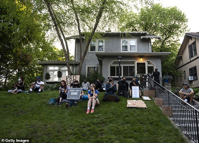 A group of protesters gathered outside the home of Hennepin County Attorney Mike Freeman yesterday as part of protests against the death of George Floyd