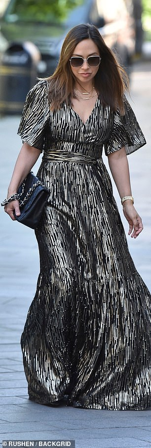 Fashionista: Her black and white gown featured a striking vertical pattern, billowing sleeves and skirt and a tie belt that cinched her in at the waist