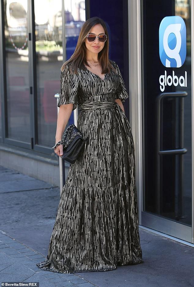 Fabulous: Myleene flashed a slight smile as she struck a pose outside Global studios