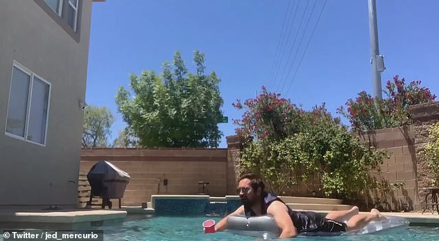 Lap of luxury:Detective Sergeant Steve then logs in from his swimming pool in Vegas (which is where actor Martin really lives) as he floats around in one of his trademark waistcoats on a lilo