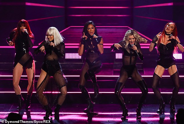 Busy bee: the singer juggled her career as a radio host with her reunion with Jessica Sutta, Kimberly Wyatt, Nicole Scherzinger and Carmit Bachar (November photo)