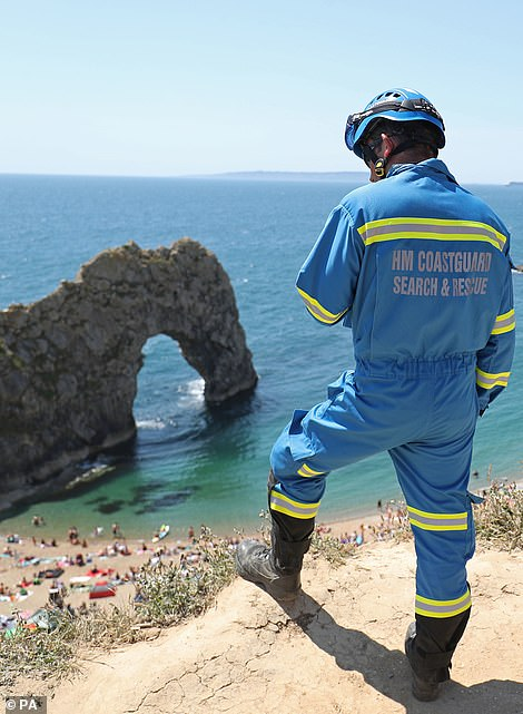 The coastguard is out patrolling at Durdle Door today. The Dorset beach is packed with visitors, despite the air ambulance landing at the beach yesterday