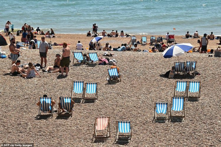 Brighton sunbathers soak up the 75F (24c) rays today on the eve of a further relaxation of the novel coronavirus lockdown rules.