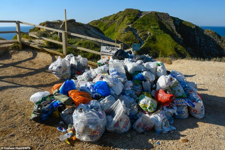 Inconsiderate visitors left this rubbish at the beach next to Durdle Door and the council warned people to stay away today following dangerous jumping yesterday