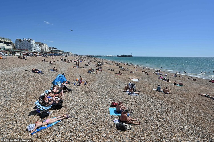 People have taken to Brighton beach today with lockdown rules still in place as groups practised social distancing at the seaside