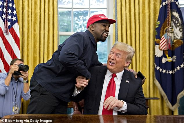 Not about politics: 'I don't think we're less friends because of the Trump thing. I just think we're doing our own thing,' he said (Kanye and Trump in 2018)