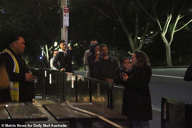 Pubgoers line upbefore being scanned in and heading to the 'Sanitising Station' at the Sydney pub