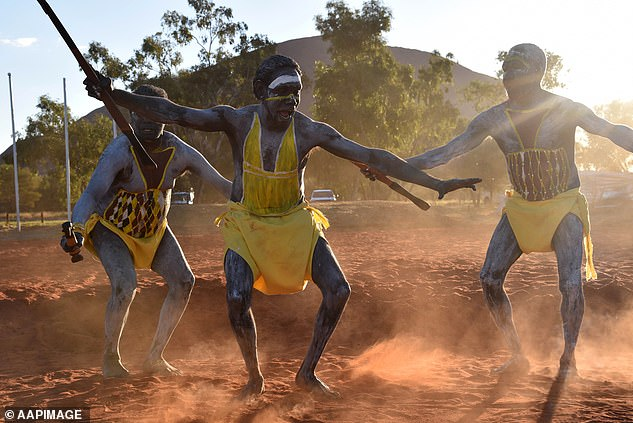 Pictured: East Arnhem Land dancers perform at Mutitjulu near Uluru. The Biosecurity Act preventing travel to remote indigenous communities is to be removed 2 weeks early