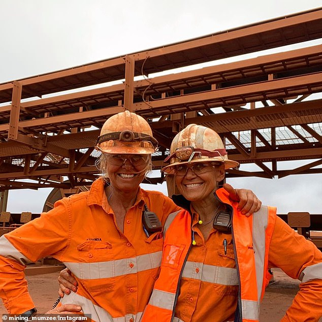 Two miners pose at a site in WA. Miners, operators, engineers and maintenance workers are in high demand as job advertisements in the mining, resources and energy industry have increased, according to Seek