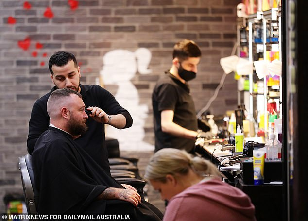 Lee Qaqos, a Stanhope Gardens barber, told Daily Mail Australia business was finally beginning to return to normal