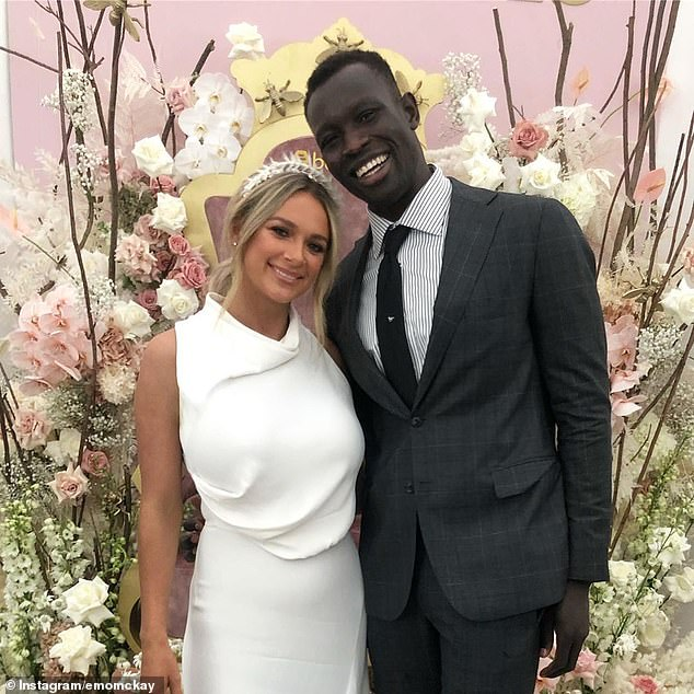 Majak Daw (pictured with girlfriend Emily McKay) will make his fairytale return to the AFL in as little as three weeks after surgeons told him his torn pectoral muscle does not need to be operated on