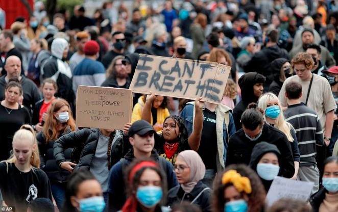 Demonstrators held up signs reading 'I can't breathe' and 'no justice no peace' with chants echoing through the city on Monday afternoon