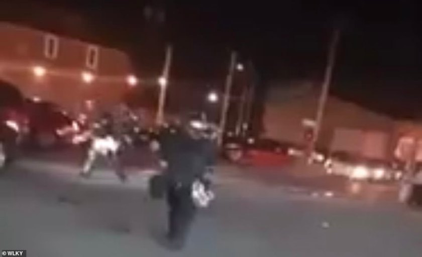 A protester has been shot dead by law enforcement officers in Louisville on the fourth night of unrest following the death of unarmed black man George Floyd. Pictured: Police at the scene last night