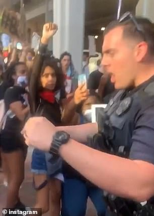 Pohorence is seen yelling at protesters