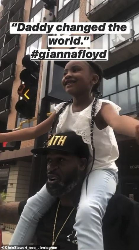 Gianna Floyd, on her uncle's shoulders, on Tuesday in Minneapolis, saying: 'Daddy changed the world'