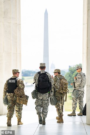 Two National Guard members on duty in Washington D.C. were injured by lightning early Friday morning. Pictured, members of the DC National Guard gear-up after a short rest from standing guard at the Lincoln Memorial