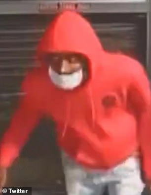 One of the suspects was seen wearing a bright red hoodie as he made his way into the premises