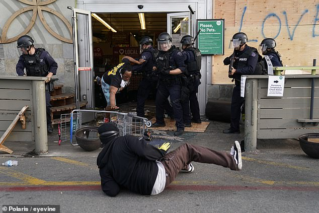 Police arrest looters Whole Foods Market last weekend in the Fairfax district of Los Angeles