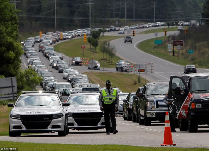 RAEFORD, NORTH CAROLINA: Hundreds of cars line up as mourners arrive for public viewing of George Floyd