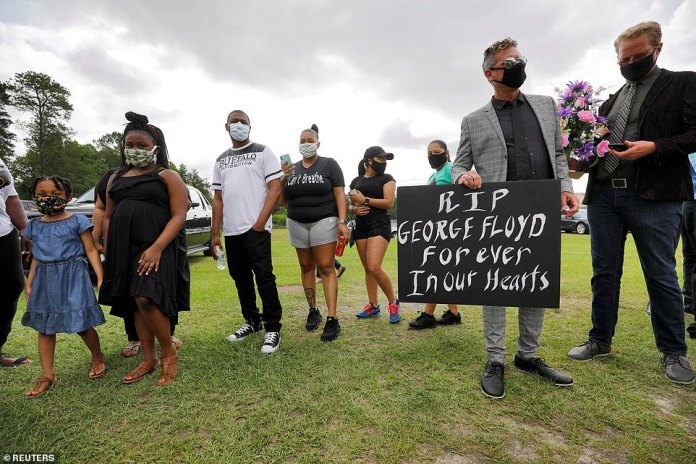RAEFORD, NORTH CAROLINA: Groups of mourners wearing masks lined up in hundreds at the Floyd memorial