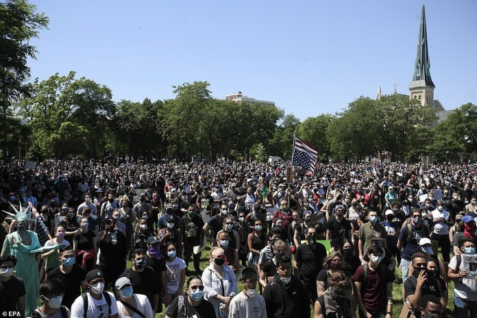 CHICAGO, ILLINOIS: Protesters gather to prepare to walk from Union Park to Chicago on Saturday