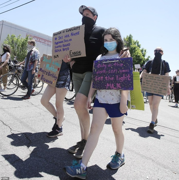 CHICAGO, ILLINOIS: Young protesters joined the Chicago march as peaceful protesters left Union Park, Chicago
