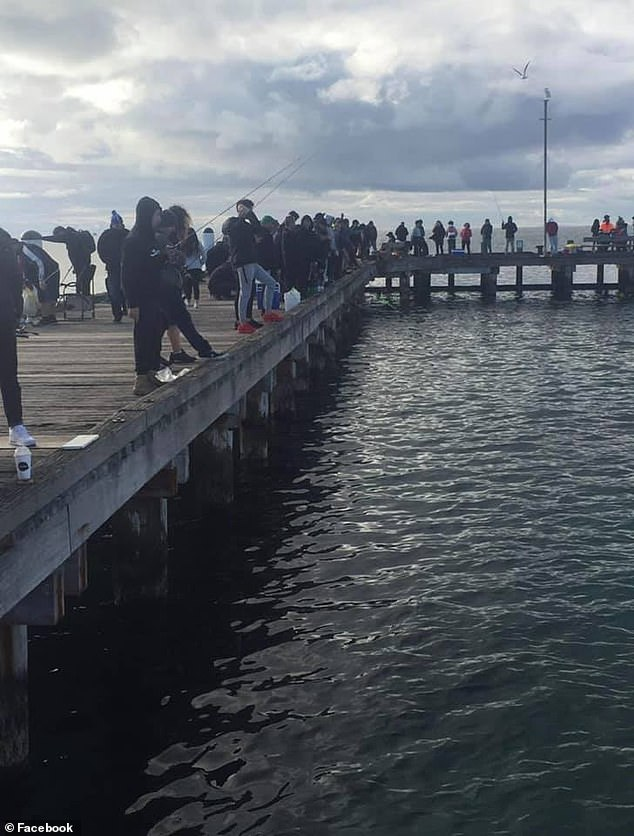 A popular pier south-east of Melbourne has been shut down after hundreds of people failed to socially distance (pictured)