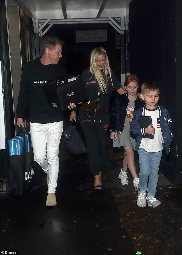 The celebrations continue: Roxy Jacenko wrapped up her 40th birthday weekend on Monday night with a lavish family dinnerin Potts Point, Sydney. Pictured with her husband, Oliver Curtis, and their children, Pixie and Hunter