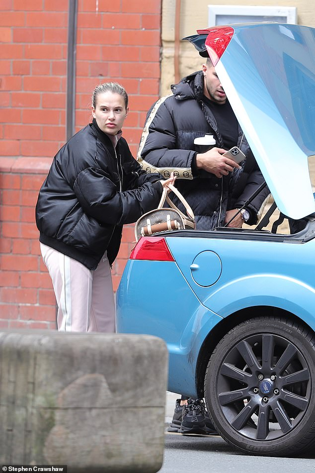 First sighting: Molly-Mae Hague and her boyfriend Tommy Fury were photographed for the first time since the death of their dog, Mr Chai, in Manchester on Tuesday
