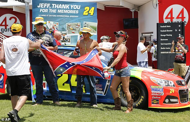 Confederate flags are a common sight for NASCAR, which originated in the south and remains a large part of the region's identity. Race fans take a photo with a Confederate flag in the Fan Zone before a NASCAR Sprint Cup series auto race at Daytona International Speedway in 2015
