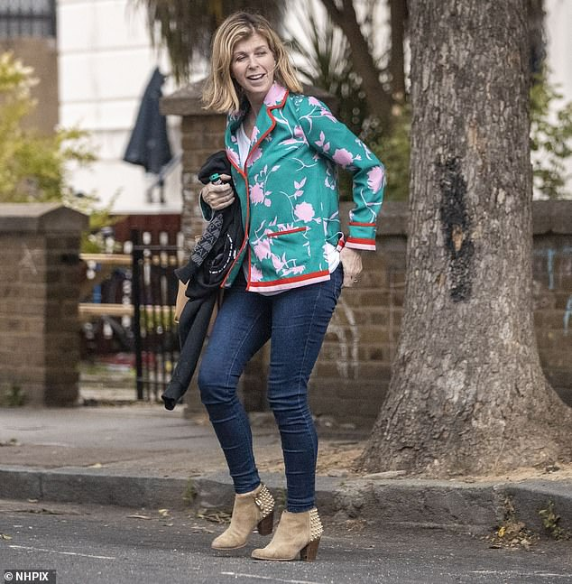 Gorgeous: mother of two looked glamorous in a green floral blazer paired with jeans and beige heeled ankle boots