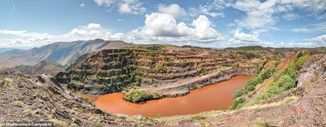 A truly historic site, perhaps the world's first mine: red ochre was dug here over 40,000 years ago. This terraced pit is modern, says David, a relic of an open-cast mine begun in 1966 and currently not being worked