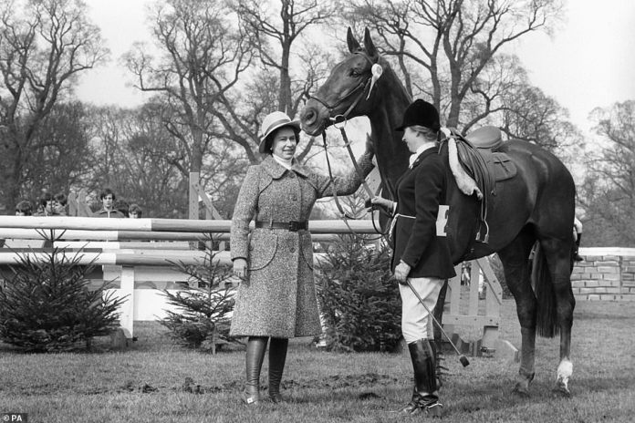 The monarch pats Doublet, who was bred as a polo pony and became the horse that Princess Anne won the European Eventing Championships at Burghley in 1971, while standing next to her daughter princess Anne