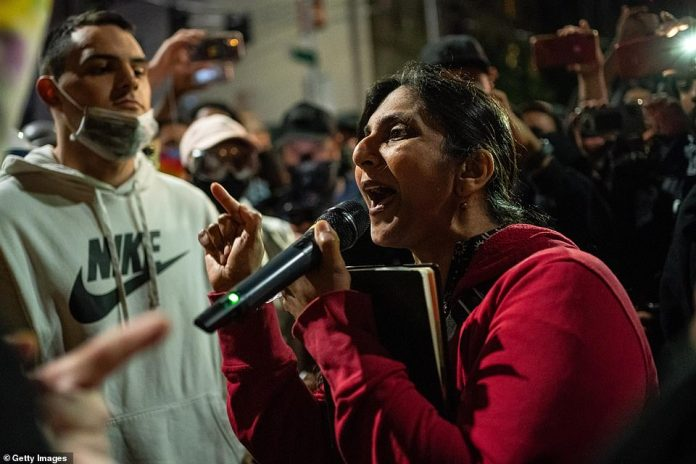 Seattle City Council member Kshama Sawant, spokesperson for Mayor Jenny Durkan, speaks at a rally on Monday