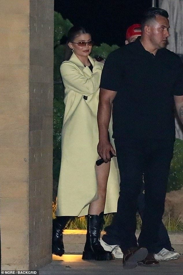 Rocking it: Kylie was as elegant as ever wearing a designer yellow feather duster while leaving celebrity's favorite restaurant with her 27-year-old musician friend