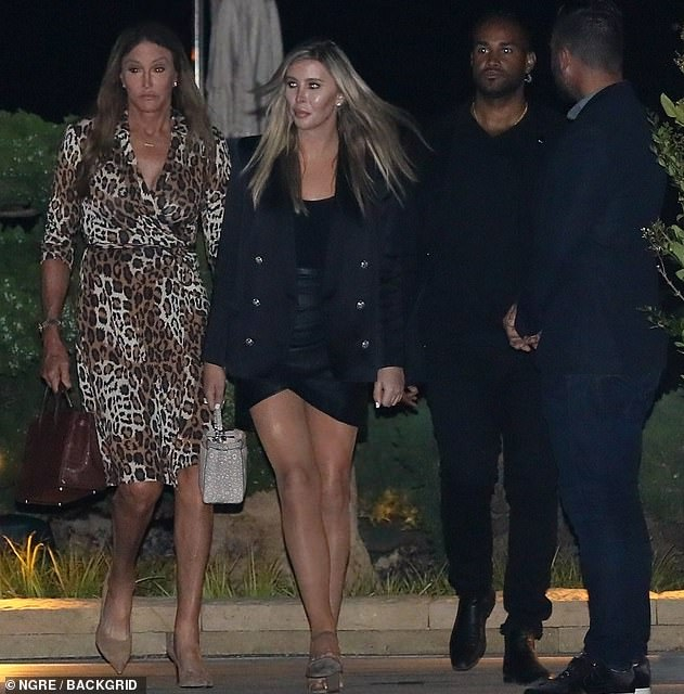 Mover and shaker: Caitlyn slipped her figure enviously into a leopard print cocktail dress, accessorizing with a mahogany leather handbag