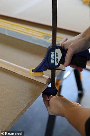 Keira can be seen lining up her dowels on the MDF board and then gluing it down