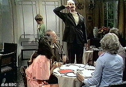 An episode of Fawlty Towers (pictured) from which the N-word and other offensive terms had previously been cut has been taken down from the BBC's UKTV player. John Cleese (centre as Basil Fawlty) branded the channel 'stupid' for not realising it is mocking racist people