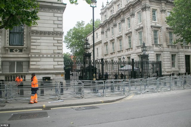 Security barriers are placed in Whitehall outside Downing Street, where protesters have repeatedly attacked police officers