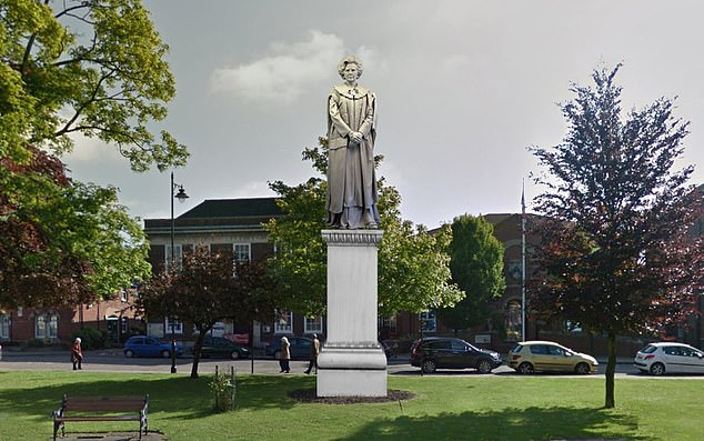 Artist's impression: With a 10.5ft sculpture atop a 10.5ft plinth, the proposed statue would dominate the quiet town square in Margaret Thatcher's home town of Grantham
