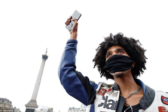 A demonstrator gestures during a Black Lives Matter protest in Trafalgar Square, this afternoon during the protest