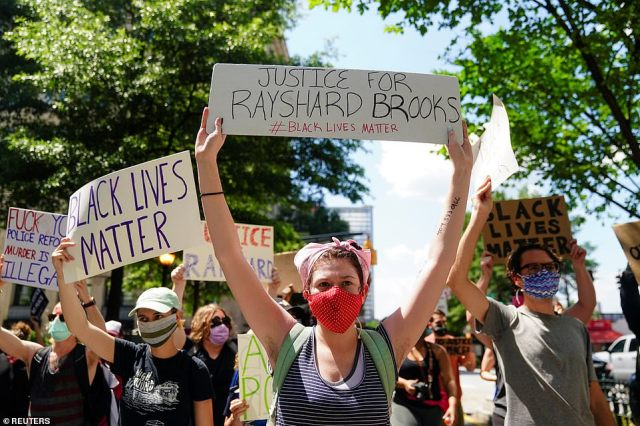Hundreds of protesters gathered in Atlanta on Saturday to protest the police shooting of Rayshard Brooks