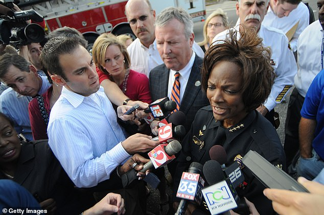 Val Demings and Buddy Dyer, mayor of Orlando, pictured in November 2009 in the Florida city