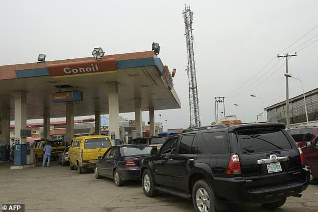 Motorists queue to buy petrol at a Lagos filling station