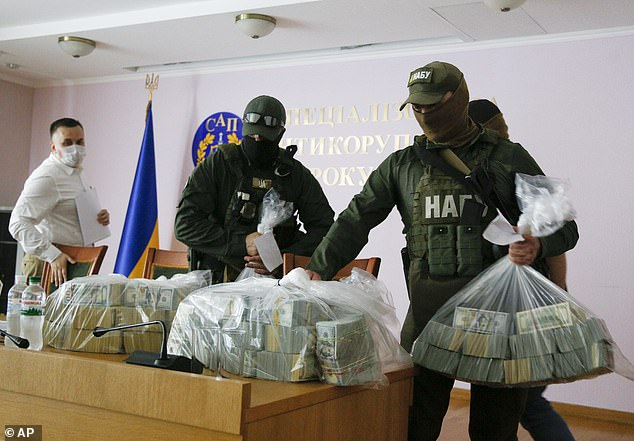 Authorities put on display the seized cash at a press conference in Kiev, Ukraine, Saturday